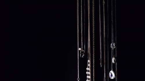 Necklaces Hanging On Black Photo
