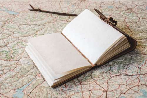Open Notebook On World Map Photo