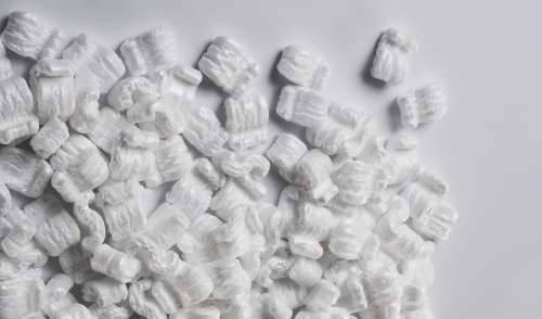 Packing Peanuts On White Table Photo