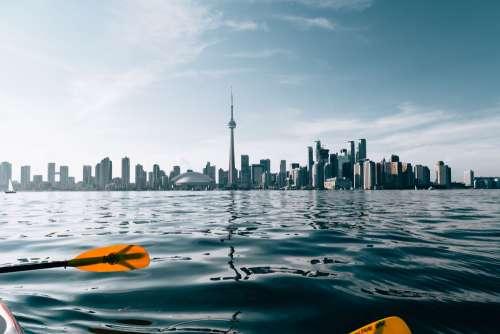 Paddling By City Skyline Photo