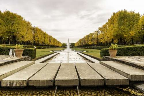 Paved Bridge over Fountain And Pond Photo