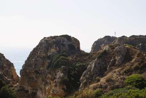 Peeking Through The Cliffside To The Sea Photo