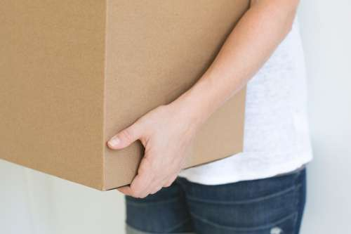 Person Holding Box Photo