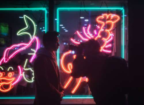 Photographer And Model In Neon Light Photo