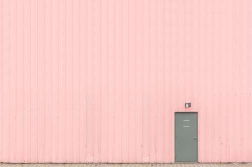 Pink Wall With Grey Door Photo