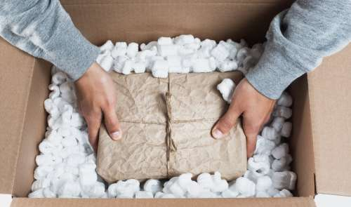 Placing A Package In Packing Material Photo