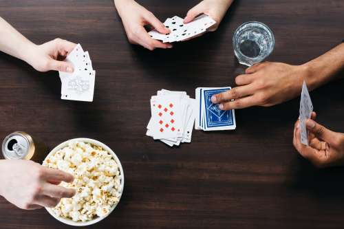 Playing Card Games At A Table Photo