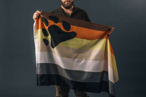 Portrait Of A Man Holding Bear Pride Flag Photo