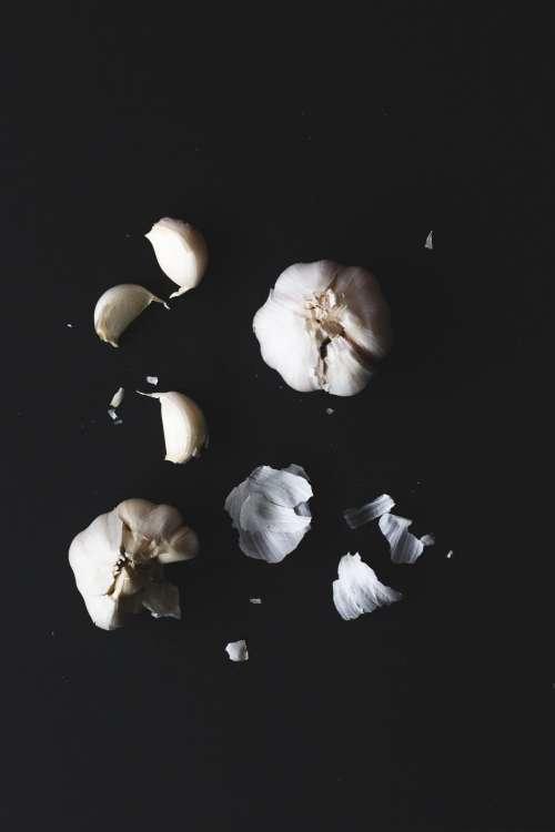 Portrait Of Garlic Cloves On A Black Background Photo