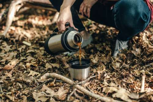Pouring Coffee In The Wilderness Photo