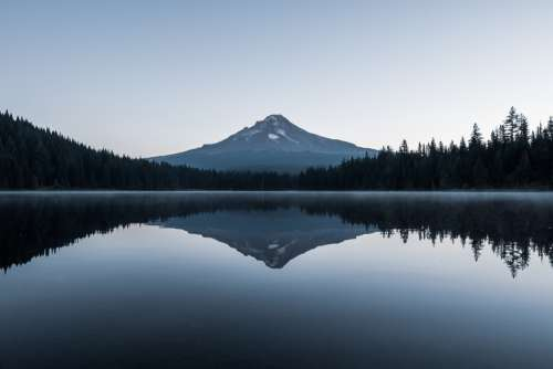 Prefect Reflection Of Mountain In Water Photo