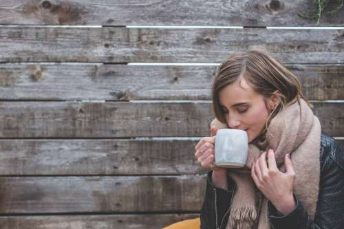 Woman Sipping Coffee Photo