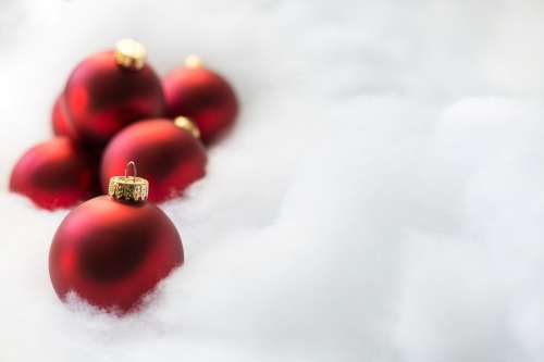 Red Ornaments On White Snow Photo