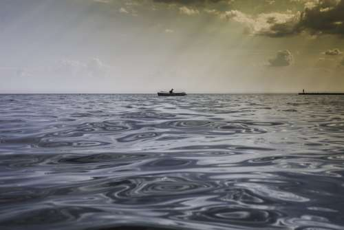 Row Boat On Calm Water Photo