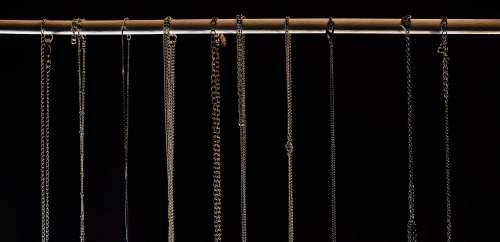 Row Of Necklace Chains Close Up Photo