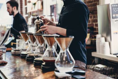 Row Of Pour Over Coffee Being Brewed Photo