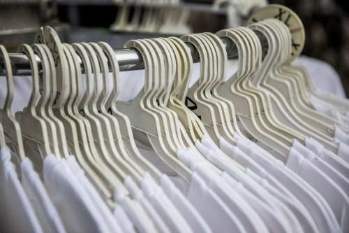 Rows Of Hangers With White T-Shirts Photo