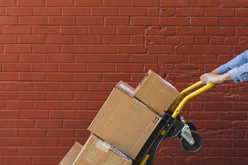 Shipping Boxes On Red Brick Photo