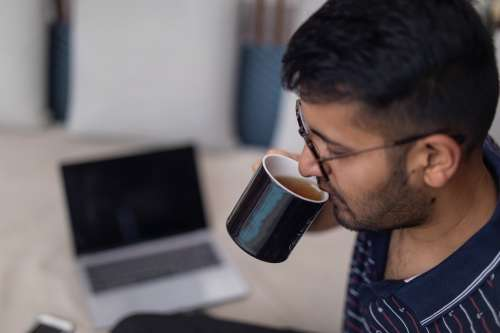 Sipping Tea In Modern Workspace Photo