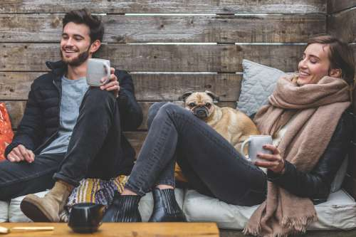 Smiling Man Woman Pug Photo