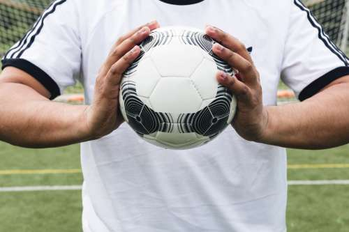 Soccer Ball In Athletes Hands Photo