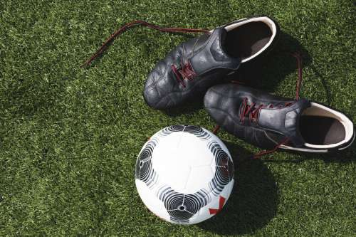 Soccer Cleats And Ball Photo