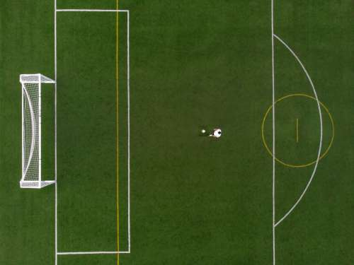 Soccer Player In Penalty Position Drone View Photo