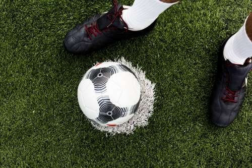 Soccer Player With Ball On Field Photo