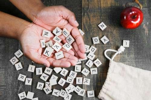 Spelling Game Letter Tiles In Hand Photo