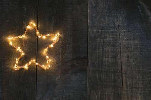 Star Light On Woodgrain Photo