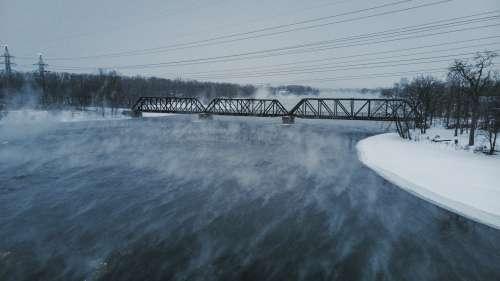 Steaming Winter Water Under Train Bridge Photo