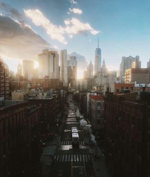 Sun Rising Behind New York Skyline Photo