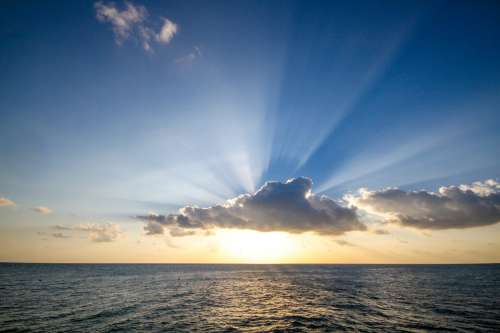 Sun Setting Over Ocean Photo
