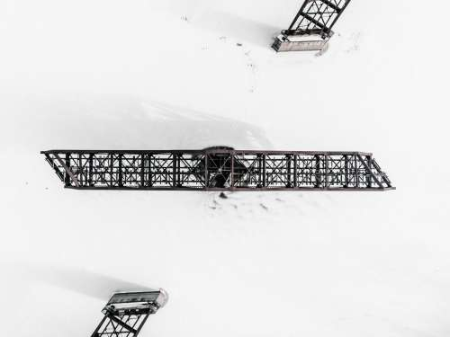 Swing Bridge Locked In Place In A Frozen River Surrounded By Snow Photo