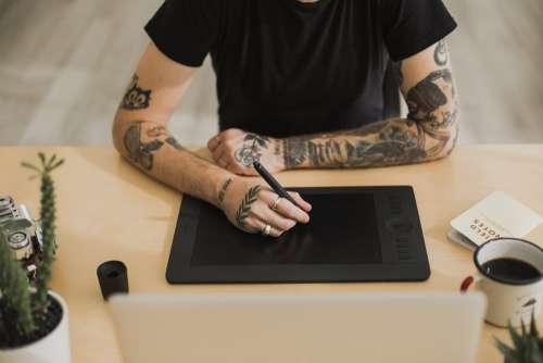 Tattood Man Using Creative Technology Photo