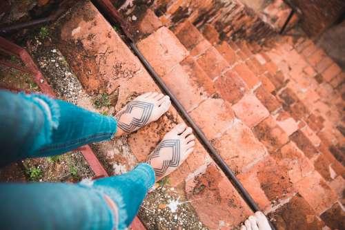 Tattooed Feet On Steep Stairs Photo