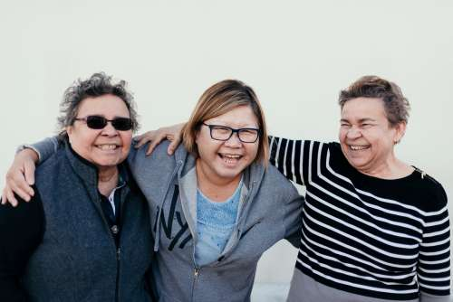 Three Mature Women Laugh In Friendship Photo