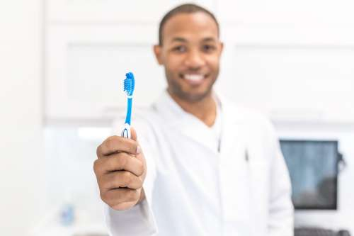 Toothbrush And Dentist Photo