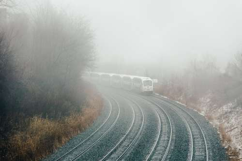 Train Turning Through Fog Photo