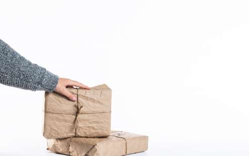 Two Packages Wrapped In Kraft Paper And Twine Photo