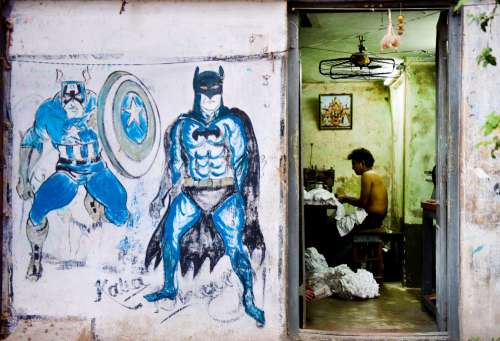 Urban Artwork And Textile Worker Photo