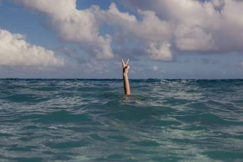 Vacation Peace Sign In Ocean Photo