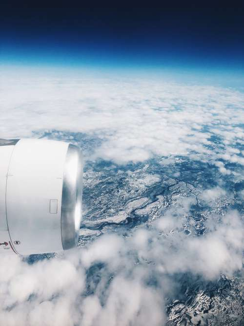 View From Airplane Window Over Snowy Continents Photo