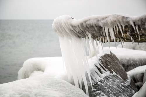 Waterside Rock With Icicles Photo