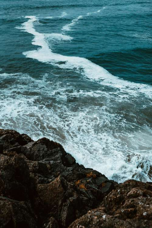 Waves Crash On Rocks Photo