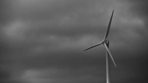 Wind Power Generator On Cloudy Day Photo