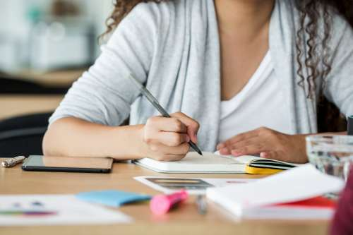 Woman At Work Taking Notes Photo