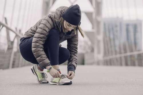 Female Athlete Tying Her Shoes Photo