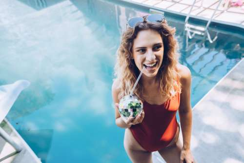 Woman By Pool With Drink Photo