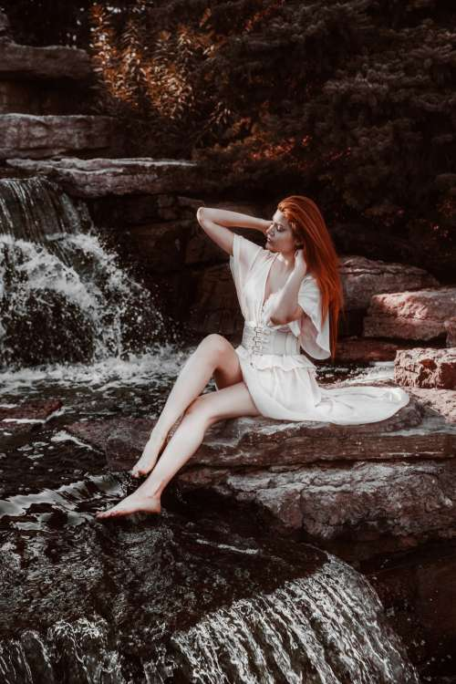 Woman By Waterfall Photo